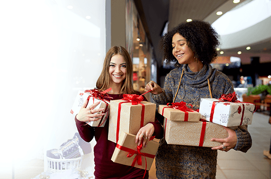 two teen girls shopping for holiday gifts